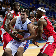 Anadolu Efes's Dario Saric (C) during their Gloria Cup Basketball Tournament match Anadolu Efes between Olympiacos at Ulker Sports Arena in istanbul Turkey on Tuesday 23 September 2014. Photo by Aykut AKICI/TURKPIX