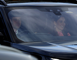 The Duke of Cambridge and the Duchess of Cambridge arriving for the Queen's Christmas lunch at Buckingham Palace, London.