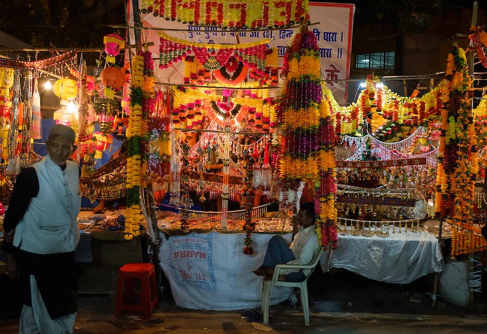 NEW DELHI, INDIA - CIRCA OCTOBER 2016: Merchant around the spice market and the Chandni Chowk area in Old Delhi at night.