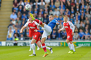 Portsmouth Midfielder, Stuart O'Keefe (7) with a clearence  during the EFL Sky Bet League 1 match between Portsmouth and Fleetwood Town at Fratton Park, Portsmouth, England on 16 September 2017. Photo by Adam Rivers.