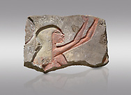 Ancient Egyptian Talatat block with a female worhiper of tambourine player relief, sandstone, New Kingdom, 18th Dynasty (1353-1336 BC), Thebes, Karnac. Egyptian Museum, Turin. Grey background.<br /> <br /> The talatat was introduced to increase the speed new monuments to Aten could be built. The talatat were smaller, about 52x26x24 cm, than the usual building blocks used and therfore were easier to handle and build with. They were first used on the new buildings of Akhenaten at Thebes during his reign, the, after his capital was moved , for the monumenta of Amarna. When Amon was restored all the Aten temples were taken down and their blocks used in other buildings. Over 100,000 talatat have been excavated so far in Thebes and they represent a massive jigsaw puzzle as archaeologist try to piece them together into their original reliefs. .<br /> <br /> If you prefer to buy from our ALAMY PHOTO LIBRARY  Collection visit : https://www.alamy.com/portfolio/paul-williams-funkystock/ancient-egyptian-art-artefacts.html  . Type -   Turin   - into the LOWER SEARCH WITHIN GALLERY box. Refine search by adding background colour, subject etc<br /> <br /> Visit our ANCIENT WORLD PHOTO COLLECTIONS for more photos to download or buy as wall art prints https://funkystock.photoshelter.com/gallery-collection/Ancient-World-Art-Antiquities-Historic-Sites-Pictures-Images-of/C00006u26yqSkDOM