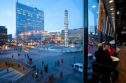 View of Sergels Torg square at dusk from inside Kulturhuset building in central Stockholm Sweden 2009