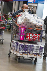 © Licensed to London News Pictures. 1/11/2020. Sheffield, UK.  A shopper wearing a face covering pushes his  trolley after shopping at Costco in Sheffield, South Yorkshire. British Prime Minister Boris Johnson announced a new four week lockdown across England, from Thursday 5 November, to contain the spread of covid-19.  Photo credit: Ioannis Alexopoulos/LNP