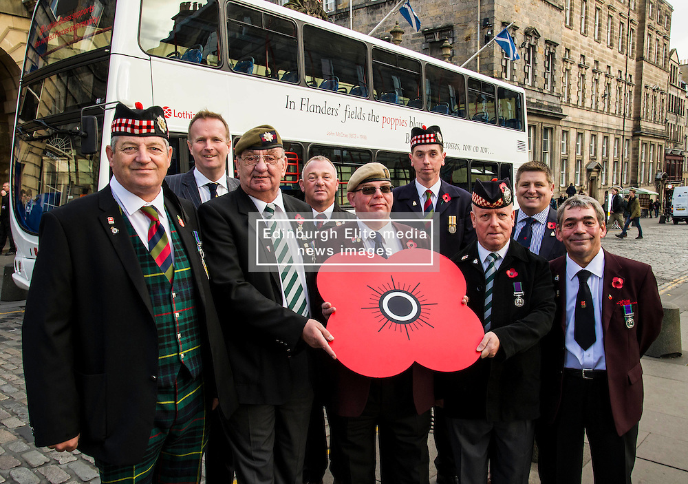 Pictured: Hugh Crawford, Willie Hamilton, John Allen, Fred Collins, Fred Donnelly, Willie Potter, Simon Allbut, John Adamson joined Gordon Michie from Poppy Scotland to launch the bus.<br /> <br /> Lothian Buses launches its 'Poppy Bus'. The vehicle, which is white with quotes from well-known war poems painted on it, will run on various routes throughout November. Ex-Forces staff and Poppy Scotland head of fundraising Gordon Michie were there to give it a good send off<br /> <br /> Ger Harley   EEm 27 October 2016
