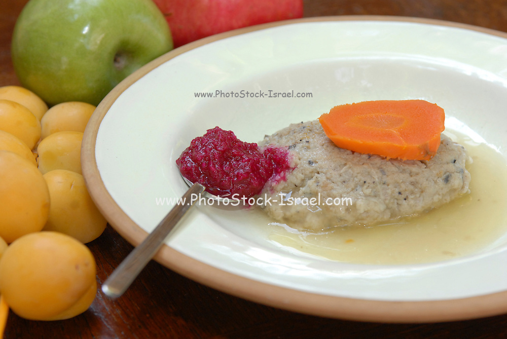 Gefilte fish and horseradish A traditional Askenazi Jewish festive dish of poached fish patties made from a mixture of ground deboned carp, traditionally eaten on the Jewish Rosh Hashana Feast and Passover Seder