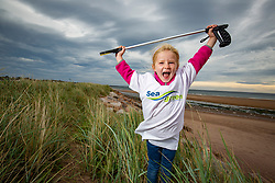 Ida Royle (3) taking part as SSE Renewables do a the beach clean in Carnoustie on Saturday morning.