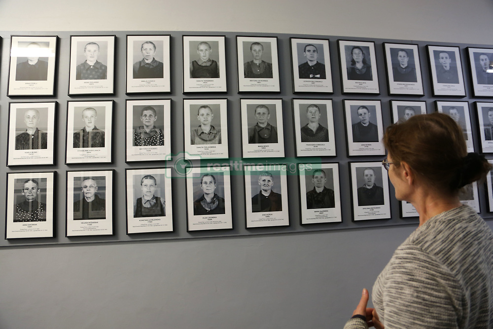 Pictures of victims are on display at Auschwitz-Birkenau Memorial and Museum in Auschwitz, Poland on September 3, 2017. Auschwitz concentration camp was a network of German Nazi concentration camps and extermination camps built and operated by the Third Reich in Polish areas annexed by Nazi Germany during WWII. It consisted of Auschwitz I (the original camp), Auschwitz II–Birkenau (a combination concentration/extermination camp), Auschwitz II–Monowitz (a labor camp to staff an IG Farben factory), and 45 satellite camps. In September 1941, Auschwitz II–Birkenau went on to become a major site of the Nazi Final Solution to the Jewish Question. From early 1942 until late 1944, transport trains delivered Jews to the camp's gas chambers from all over German-occupied Europe, where they were killed en masse with the pesticide Zyklon B. An estimated 1.3 million people were sent to the camp, of whom at least 1.1million died. Around 90 percent of those killed were Jewish; approximately 1 in 6 Jews killed in the Holocaust died at the camp. Others deported to Auschwitz included 150,000 Poles, 23,000 Romani and Sinti, 15,000 Soviet prisoners of war, 400 Jehovah's Witnesses, and tens of thousands of others of diverse nationalities, including an unknown number of homosexuals. Many of those not killed in the gas chambers died of starvation, forced labor, infectious diseases, individual executions, and medical experiments. In 1947, Poland founded a museum on the site of Auschwitz I and II, and in 1979, it was named a UNESCO World Heritage Site. Photo by Somer/ABACAPRESS.COM