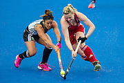 Great Britain's Hollie Webb is tackled by Maria Granatto of Argentina. Great Britain v Argentina  - Hockey Champions Trophy, Lee Valley Hockey & Tennis Centre, London, UK on 18 June 2016. Photo: Simon Parker