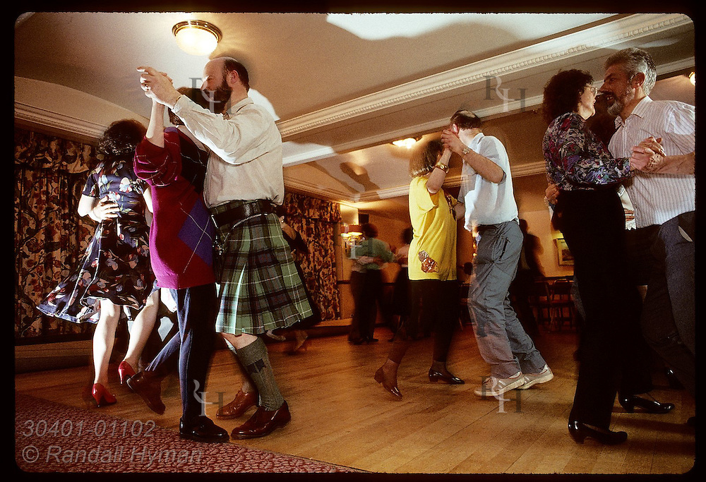 Dancers whirl across the floor at traditional ceilidh dance at the Black Bull Hotel; Milngavie. Scotland