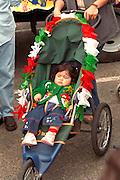 Spectator age 2 fully decorated at Cinco de Mayo festival.  St Paul Minnesota USA
