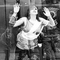 As part of Streets Ahead various shop windows on Bold Street had living mannequin's in by a group called Cacahuète. This one was trapped and desperate to get out.
