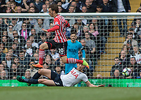 Football - 2016 / 2017 Premier League - Tottenham Hotspur vs. Southampton<br /> <br /> Manolo Gabbiadini of Southampton leaps over the sliding tackle of Jan Vertonghen of Tottenham<br /> at White Hart Lane.<br /> <br /> COLORSPORT/DANIEL BEARHAM