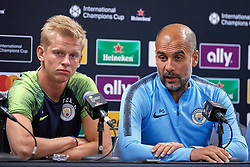 """July 19, 2018 - Chicago, IL, U.S. - CHICAGO, IL - JULY 19: Manchester City head coach Josep Ã'PepÃ"""" Guardiola and defender Oleksandr Zinchenko (35) answer questions from the media during Manchester CityÃ•s press conference ahead of the International Champions Cup match between Manchester City and Borussia Dortmund on July 19, 2018 held at Soldier Field in Chicago, Illinois. (Photo by Robin Alam/Icon Sportswire) (Credit Image: © Robin Alam/Icon SMI via ZUMA Press)"""