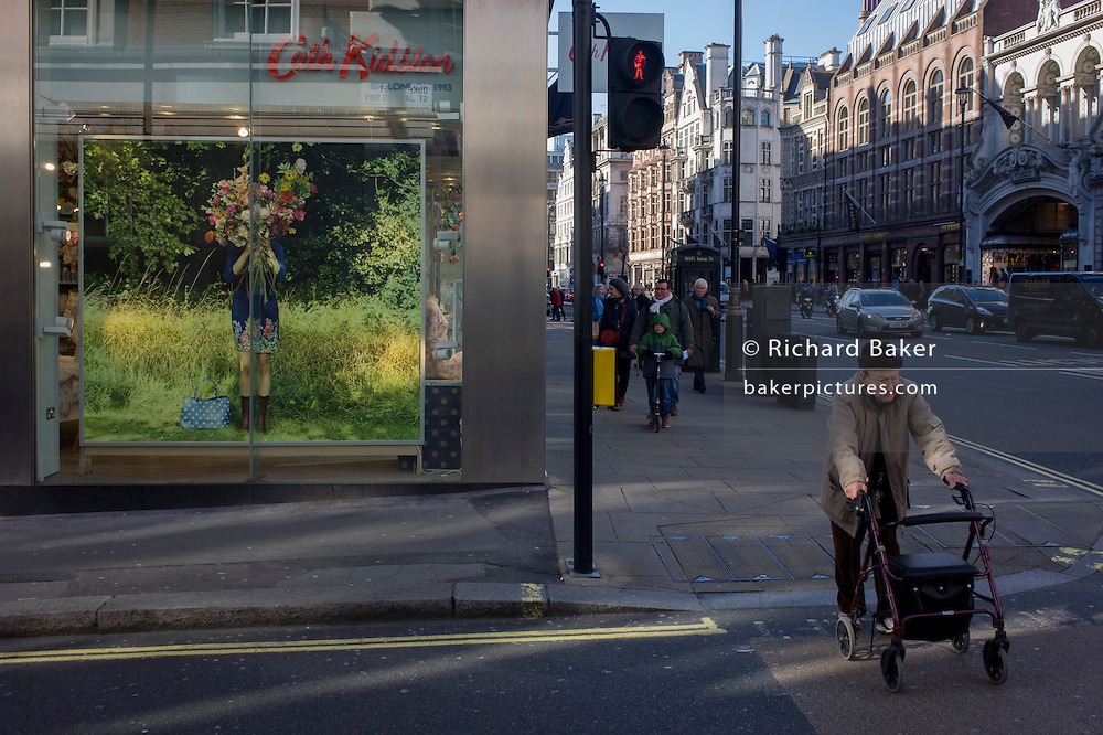An elderly man ventures across the road outside the Piccadilly branch of British fashion brand Cath Kidston on the corner of Duke Street, central London.