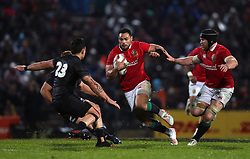 British and Irish Lions' Ben Te'o runs at Maori All Blacks' Rob Thompson during the Tour match at the Rotorua International Stadium.