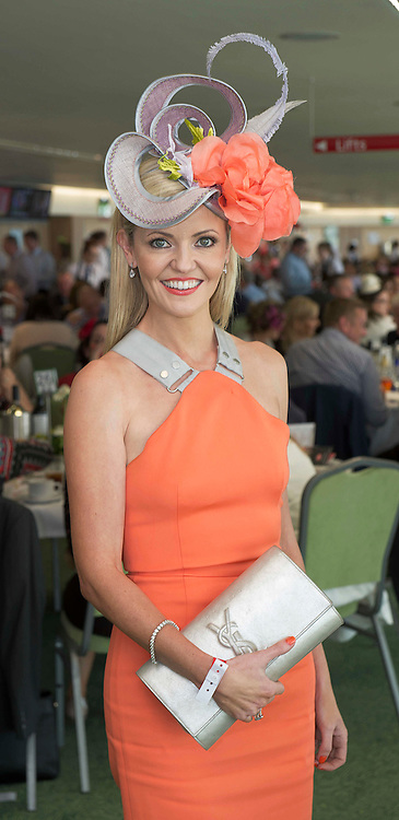 """30/07/2014 Annemarie McManus (JP's daughter-in-law) from Ballsbridge who won the Lydon House  Catering event """"Handbags, Hat and Heels"""" competition on the top floor of the Killlanin Stand at the Galway Racecourse sponsored by PIA Boutique. <br /> Annemarie said """"I'm estatic and delighted and I'll be in to Pia tomorrow"""". <br /> Annemarie wore a Irish Milliner headpiece by Niamh Reilly and aYSL Handbag and shoes by Louboutin. Photo:Andrew Downes"""