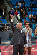 Moscow, Russia, 17/10/2004..The WTA Kremlin Cup tennis tournament.  Women's singles champion Anastasia Myskina applauds as Moscow Mayor Yuri Luzhkov waves a trophy presented to the city of Moscow by the Women's Tennis Association for the best organised WTA tournament of the season.