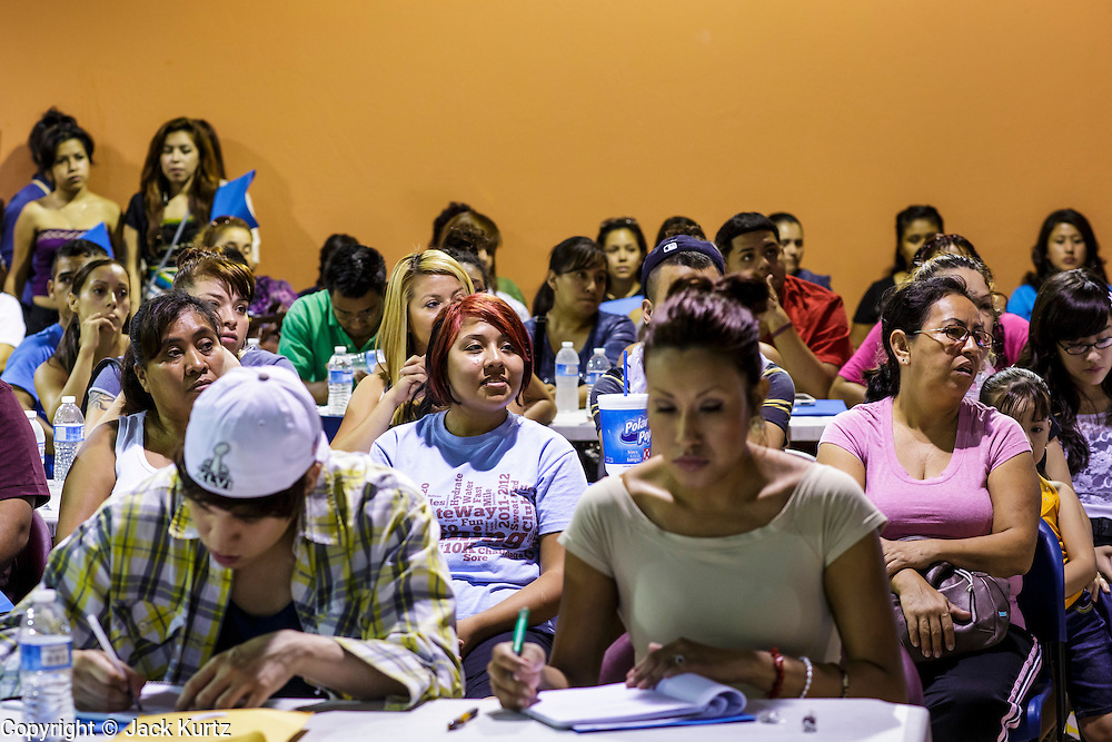 """18 AUGUST 2012 - PHOENIX, AZ:  People listen to immigration lawyers talk about the """"deferred action"""" program during a deferred action workshop in Phoenix. More than 1000 people attended a series of 90 minute workshops in Phoenix Saturday on the """"deferred action"""" announced by President Obama in June. Under the plan, young people brought to the US without papers, would under certain circumstances, not be subject to deportation. The plan mirrors some aspects the DREAM Act (acronym for Development, Relief, and Education for Alien Minors), that immigration advocates have sought for years. The workshops were sponsored by No DREAM Deferred Coalition.  PHOTO BY JACK KURTZ"""