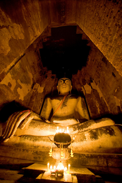 Sukhothai, Thailand ancient temples shot at night with candles and a long exposure.