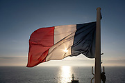 French tricolore flag flies on board a Brittany Ferries roll-on / roll-off car and vehicle ferry on 26th September 2021 in Roscoff, Brittany, France. Brittany Ferries is the trading name of the French shipping company, BAI Bretagne Angleterre Irlande S.A. founded in 1973 by Alexis Gourvennec, that operates a fleet of ferries and cruise ferries between France and the United Kingdom.