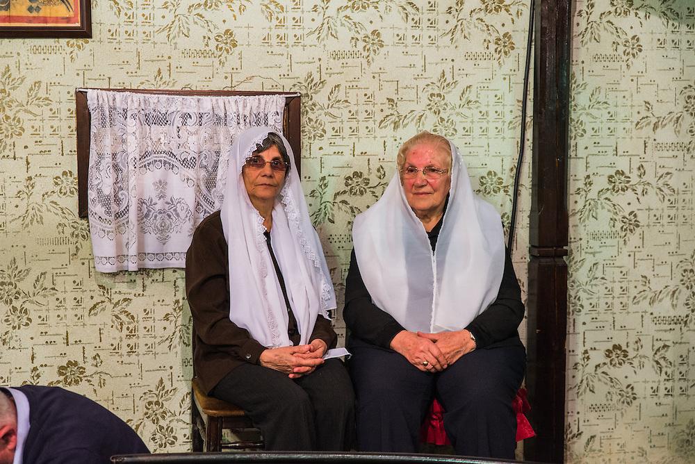 Elderly women watch Saturday evening's Zikr