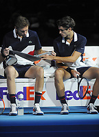 Tennis - 2018 Nitto ATP Finals at The O2 - Day Two<br /> <br /> Group Doubles Group Llodra/Santoro: Oliver Marach (AUT) & Mate Pavic (CRO) vs. Pierre - Hughes Herbert (FRA) & Nicolas Mahut (FRA)<br />  <br /> Nicolas Mahut unwraps  an ankle support for his injury in between games<br /> <br /> <br /> COLORSPORT/ANDREW COWIE