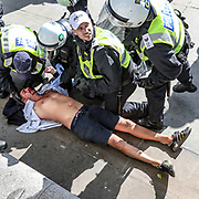A wounded member of a far-right group is escorted by British police officers in riot gear, during scuffles as they try to contain a protest at Trafalgar Square in central London, Saturday, June 13, 2020. British police have imposed strict restrictions on groups protesting in London Saturday in a bid to avoid violent clashes between protesters from the Black Lives Matter movement, as well as far-right groups that gathered to counter-protest. <br /> Anger against systemic levels of institutional racism has raged through the city, and worldwide; sparked by the death of George Floyd, who was killed in Minneapolis, US, by a policeman who restrained him with force on 25 May 2020. (Photo/ Vudi Xhymshiti)