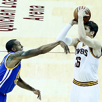 07 June 2017: Cleveland Cavaliers guard Kyle Korver (26) takes a jump shot over Golden State Warriors forward Andre Iguodala (9) during the Golden State Warriors 118-113 victory over the Cleveland Cavaliers, in game 3 of the 2017 NBA Finals, at  the Quicken Loans Arena, Cleveland, Ohio, USA.