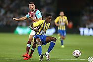 Omar Beckles of Accrington Stanley blocks the ball from Jonathan Calleri of West Ham United. EFL Cup, 3rd round match, West Ham Utd v Accrington Stanley at the London Stadium, Queen Elizabeth Olympic Park in London on Wednesday 21st September 2016.<br /> pic by John Patrick Fletcher, Andrew Orchard sports photography.