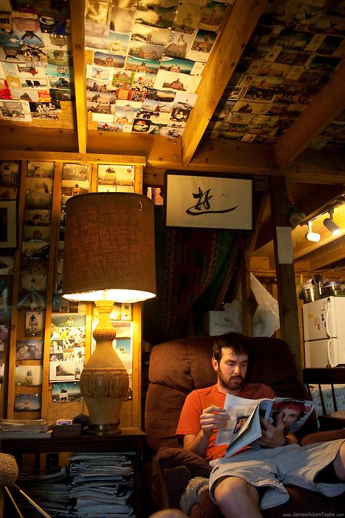 Thru-Hiker Union Break catches up on reading at the Kinora Hiker Hostel.