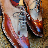 Brown wingtips and argyle socks
