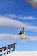 SHOT 12/17/10 2:45:40 PM - Sondre Tiller of Moelv, Norway goes big off a rail during Snowboard Slopestyle qualifiers at the Nike 6.0 Open stop of the Winter Dew Tour at Breckenridge Ski Resort in Breckenridge, Co. The event features ski and snowboard slopestyle and superpipe. (Photo by Marc Piscotty / © 2010)