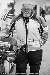 Ron Roberts at a gas stop during Stage 8 of the Motorcycle Cannonball Cross-Country Endurance Run, which on this day ran from Junction City, KS to Burlington, CO., USA. Saturday, September 13, 2014.  Photography ©2014 Michael Lichter.