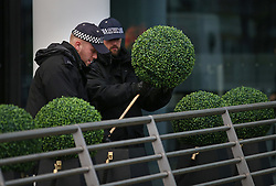 © Licensed to London News Pictures. 18/11/2015. London, UK Policemen search bushes at Wembley stadium ahead of the England v France football match. Photo credit: Peter Macdiarmid/LNP