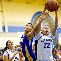 030113  Adron Gardner/Independent<br /> <br /> Zuni Thunderbird Tamika Thompson (4), left, Navajo Pine Warrior Raecal Catron (22) vie for a rebound during the the 1-2A district final in Navajo Friday.