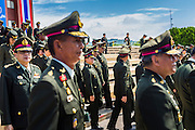 29 SEPTEMBER 2014 - NAKHON NAYOK, NAKHON NAYOK, THAILAND: Senior Thai army officers walk into the retirement ceremony for more than 200 Thai generals including Gen. Prayuth Chan-ocha, who led the 22 May coup against the civilian government earlier this year. Prayuth has been chief of the Thai army since 2010. After his retirement, Gen. Prayuth will retain his posts as head of the junta's National Council for Peace and Order (NCPO) and Prime Minister of Thailand. Under Thai law, military officers must retire at 60 years of age. The 200 generals who retired with Prayuth were also his classmates at the Chulalomklao Royal Military Academy in Nakhon Nayok.    PHOTO BY JACK KURTZ
