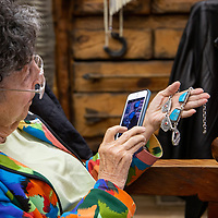 Travel writer Elaine Warner admires a unique piece of Native American jewlrey at the Tanner's Indian Arts in downtown Gallup on May 29th.