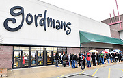 Shoppers in line outside the Gordman's store in Fairview Heights, which opened at 3 pm on Thanksgiving Day. Shoppers looking for bargains and discounted items endured a light but steady rain on Thanksgiving Day as they waited for stores to open in Fairview Heights, IL on November 28, 2019.<br />  Photo by Tim Vizer