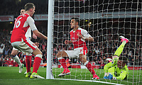 Football - 2016 / 2017 Premier League - Arsenal vs. Sunderland<br /> <br /> Alexis Sanchez of Arsenal scores his and Arsenal's first goal with a header past Pickford at The Emirates.<br /> <br /> COLORSPORT/ANDREW COWIE