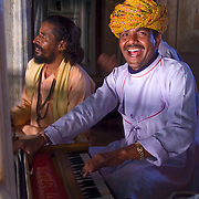Rajasthani musicians perform in the main dining room of the old palace of Bhadrawati.