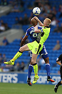Frederic Gounongbe © has his head grabbed by Reading's Paul McShane (5) as they both jump foe a header.  EFL Skybet championship match, Cardiff city v Reading at the Cardiff city stadium in Cardiff, South Wales on Saturday 27th August 2016.<br /> pic by Andrew Orchard, Andrew Orchard sports photography.