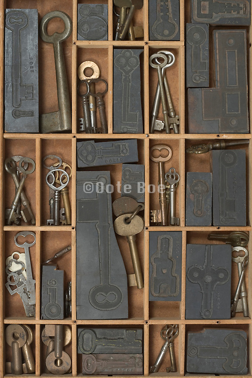 old keys and key stamps neatly arranged