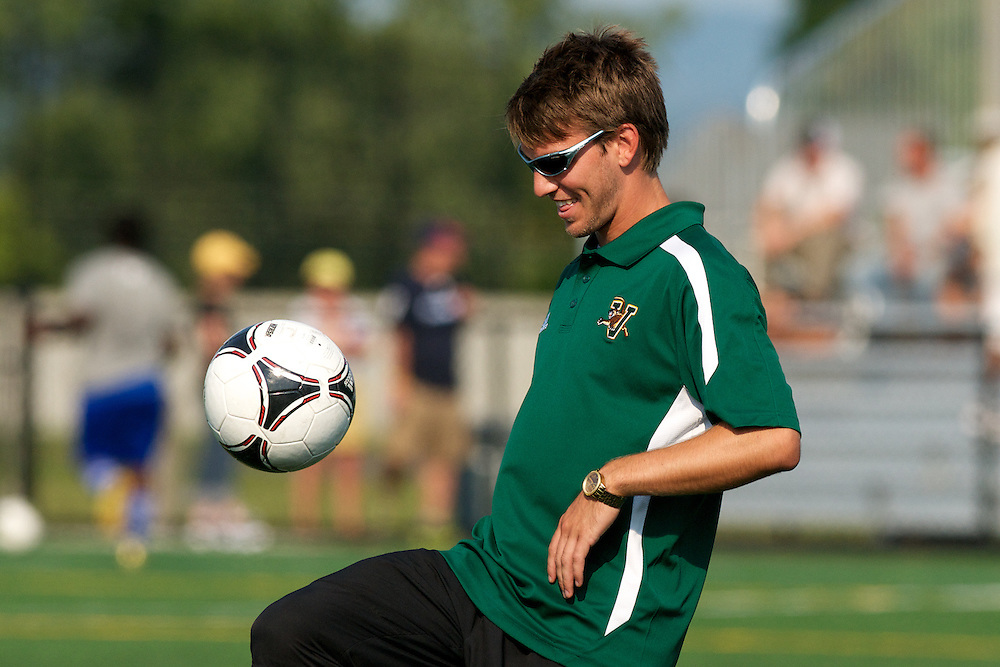 Catamounts assistant coach Ryan Horan during warm ups in the men's soccer game between the Central Connecticut State University Blue Devils and the Vermont Catamounts at Virtue Field on Friday afternoon September 7, 2012 in Burlington, Vermont.