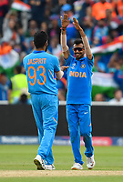 Cricket - 2019 ICC Cricket World Cup - Group Stage: Bangladesh vs. India<br /> <br /> India's Yuzvendra Chahal congratulates Jasprit Bumrah as Bangladesh's Sabbir Rahman is clean bowled for 36, at Edgbaston<br /> <br /> COLORSPORT/ASHLEY WESTERN