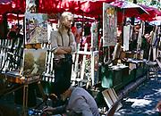 Artwork paintings artist working street stalls, Place du Tertre, Montmatre, central Paris, France 1970