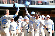19 February 2017: North Carolina's Logan Warmoth (7) celebrates his home run with Michael Busch (15). The University of North Carolina Tar Heels hosted the University of Kentucky Wildcats in a College baseball game at Boshamer Stadium in Chapel Hill, North Carolina. UNC won the game 5-4.