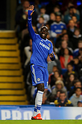 Chelsea Forward Demba Ba (SEN) waves to apologise after a long range shot goes wide during the second half of the match - Photo mandatory by-line: Rogan Thomson/JMP - Tel: 07966 386802 - 18/09/2013 - SPORT - FOOTBALL - Stamford Bridge, London - Chelsea v FC Basel - UEFA Champions League Group E