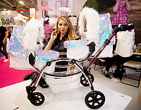 Amy Childs promoting her best-selling Polly Dolls Roma Pram Range  at the Toy Fair 2020 London Photo by Brian Jordan