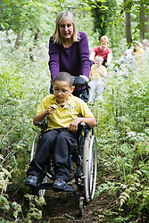 Children with physical disabilities out on a nature walk,