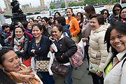 Filipino women who are all friends and live and work in London out on the Southbank for a day out together. The South Bank is a significant arts and entertainment district, and home to an endless list of activities for Londoners, visitors and tourists alike.